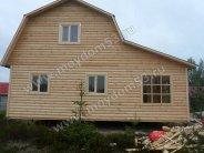 Каркасный дом 6х6 с верандой обшит блок-хаусом